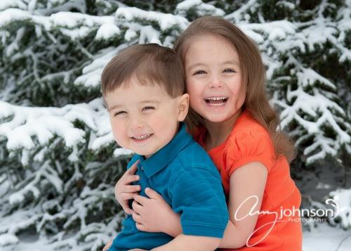 Snowy family portraits Evergreen Colorado