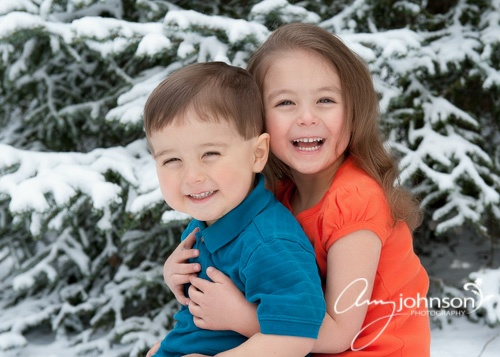 Snowy family portraits Evergreen Colorado